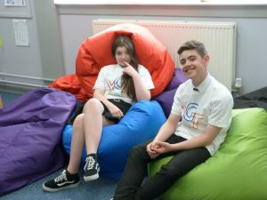 Two young people sitting on bean bags