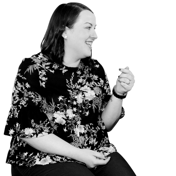 Black and white image of female MCR mentor laughing and chatting her young person