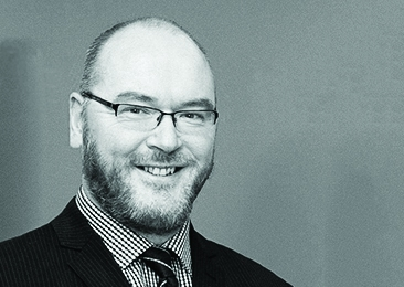 Headshot of National Advisory Group's Martin Armstrong