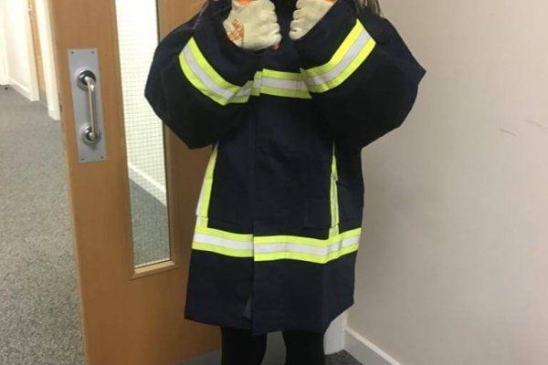 Female young Person wearing firemans outfit
